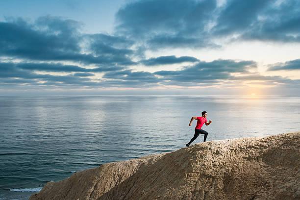 Hispanic Runner On The Bluffs Over The Ocean stock photo