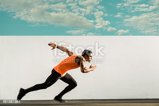 Hispanic Runner in mud stride.http://blog.michaelsvoboda.com/GilGym.JPG