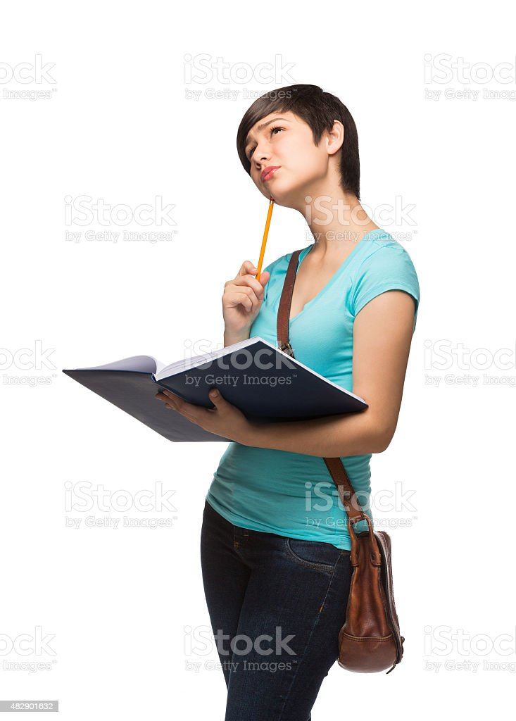 Hispanic schoolgirl thinking stock photo