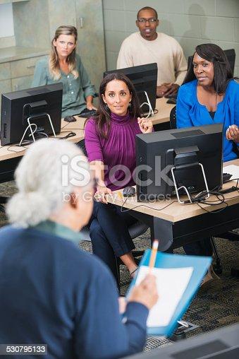 876965270 istock photo Hispanic senior man teaching adult students 530795133