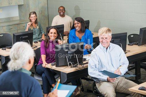 876965270 istock photo Hispanic senior man teaching adult students 532298297
