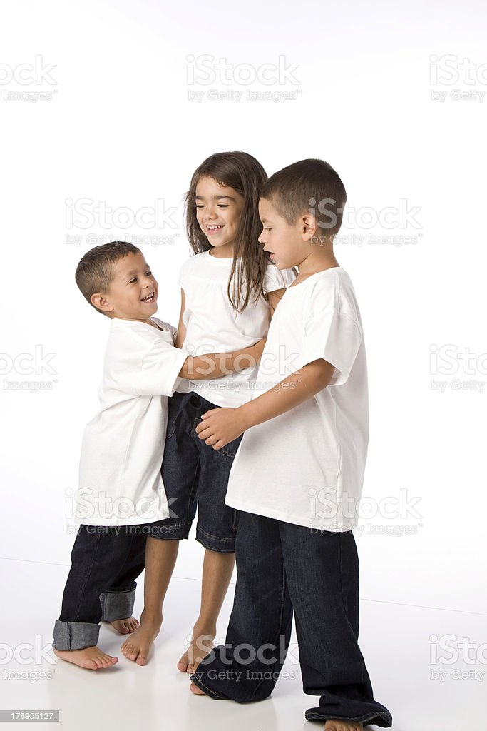 Hispanic Siblings Embrace royalty-free stock photo