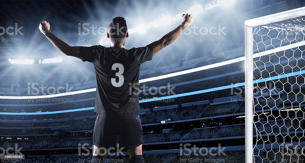 Hispanic Soccer Player Celebrating a Goal stock photo