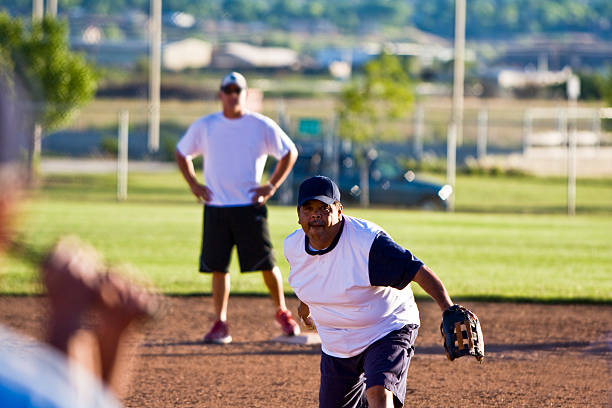 hispanic softball pitcher - softball stock photos and pictures