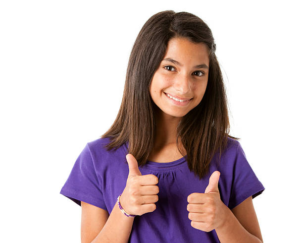 Hispanic Teen Girl Gives Thumbs Up Closeup Headshot A Hispanic teen girl gives thumbs up approval 14 15 years stock pictures, royalty-free photos & images