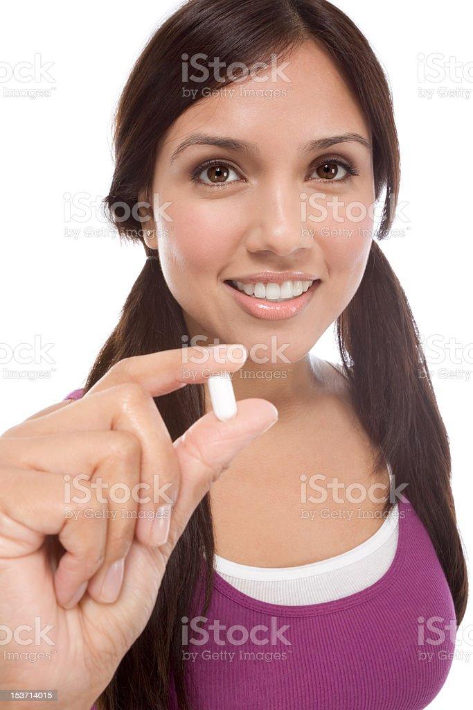 Hispanic teen girl with medicine pill royalty-free stock photo