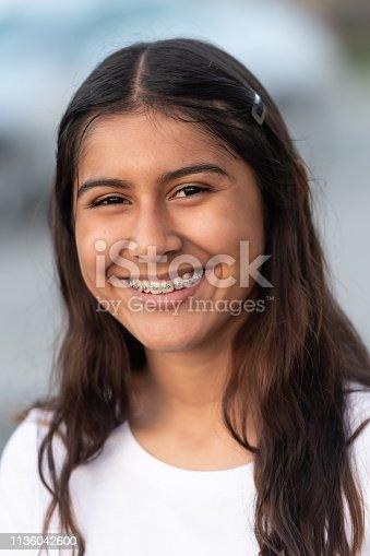 headshot of a Hispanic teenage girl looking at the camera