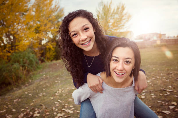 Cтоковое фото Hispanic Teenage girls having fun together outdoors