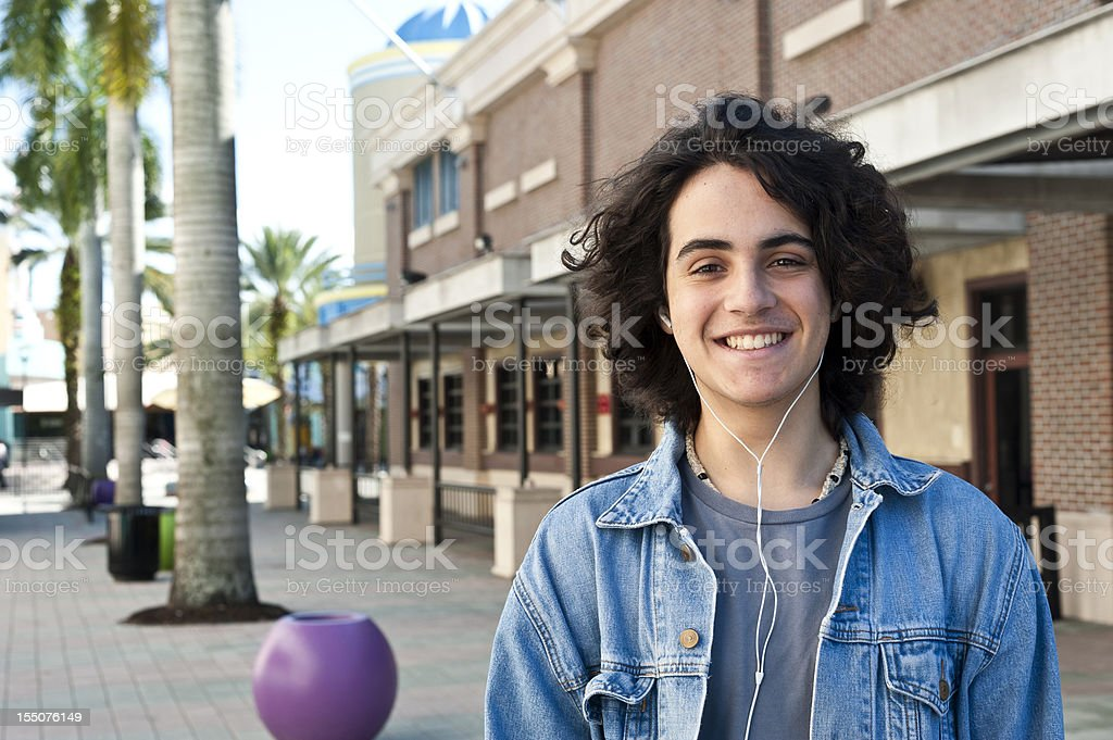 Hispanic teenager wearing his headphone royalty-free stock photo