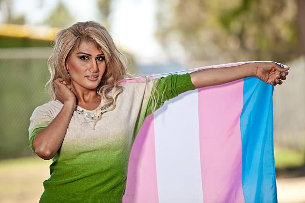 Hispanic Transgender with Pride flag stock photo