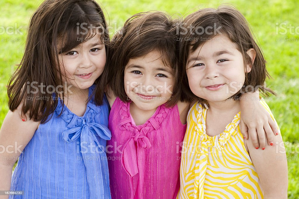 Hispanic Triplet Little Girls wearing Spring Colors stock photo