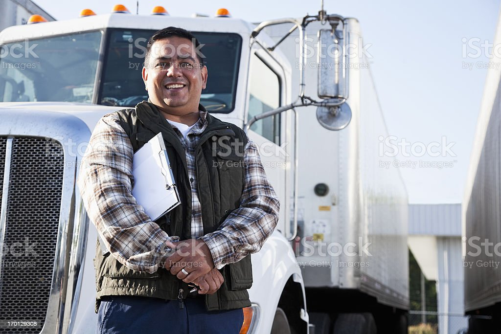 Hispanic truck driver with clipboard stock photo
