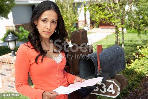 istock Hispanic Woman Checking Mailbox 184395996
