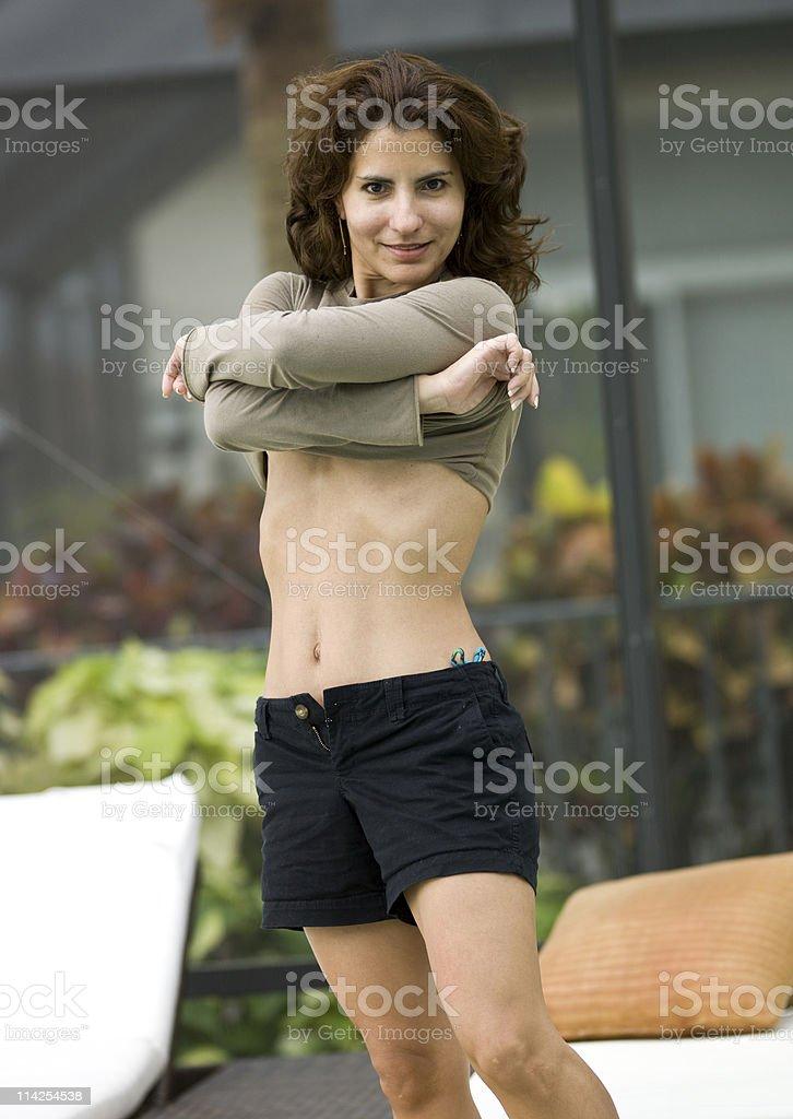 Hispanic woman getting undressed royalty-free stock photo