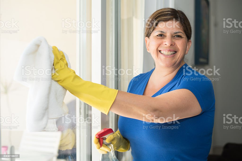Hispanic Woman housekeeping stock photo
