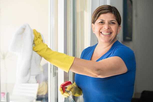 hispanic woman housekeeping - maid stock pictures, royalty-free photos & images