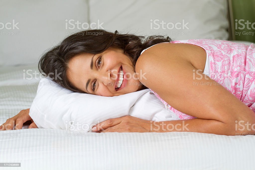 Hispanic Woman in Bed royalty-free stock photo