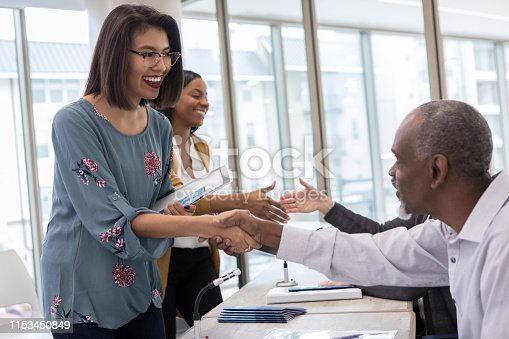 After the morning session of the small business expo, a Hispanic woman has the opportunity to shake hands with and talk to her favorite speaker.