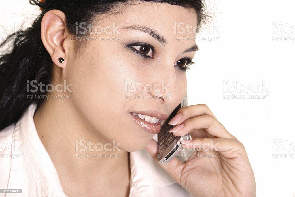 Hispanic woman on cell phone royalty-free stock photo