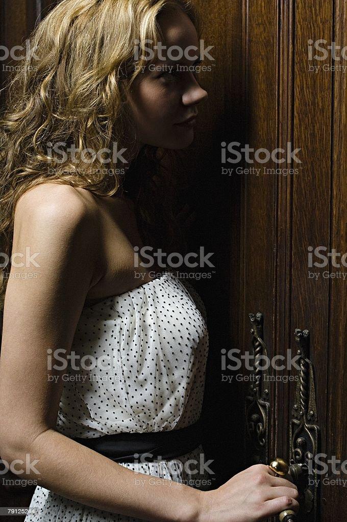 Hispanic woman opening a door royalty-free stock photo