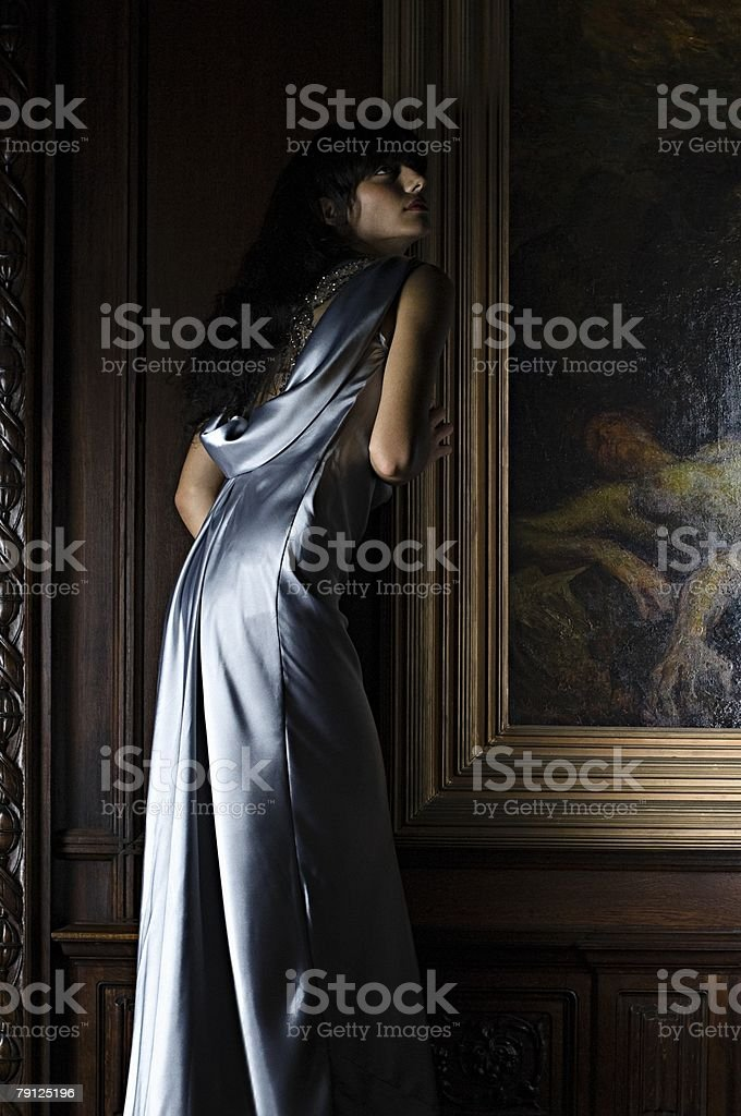 Hispanic woman standing near a painting royalty-free stock photo