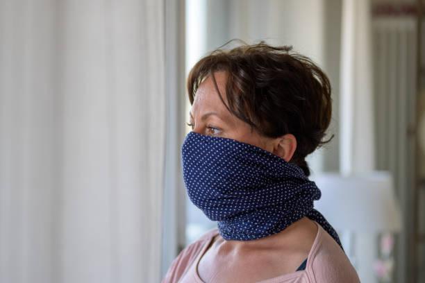 Hispanic woman wearing a blue face guard stock photo