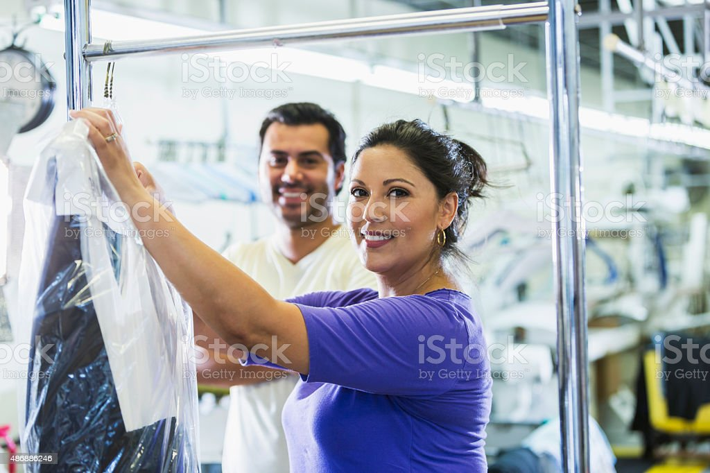 Hispanic woman working at a dry cleaner stock photo