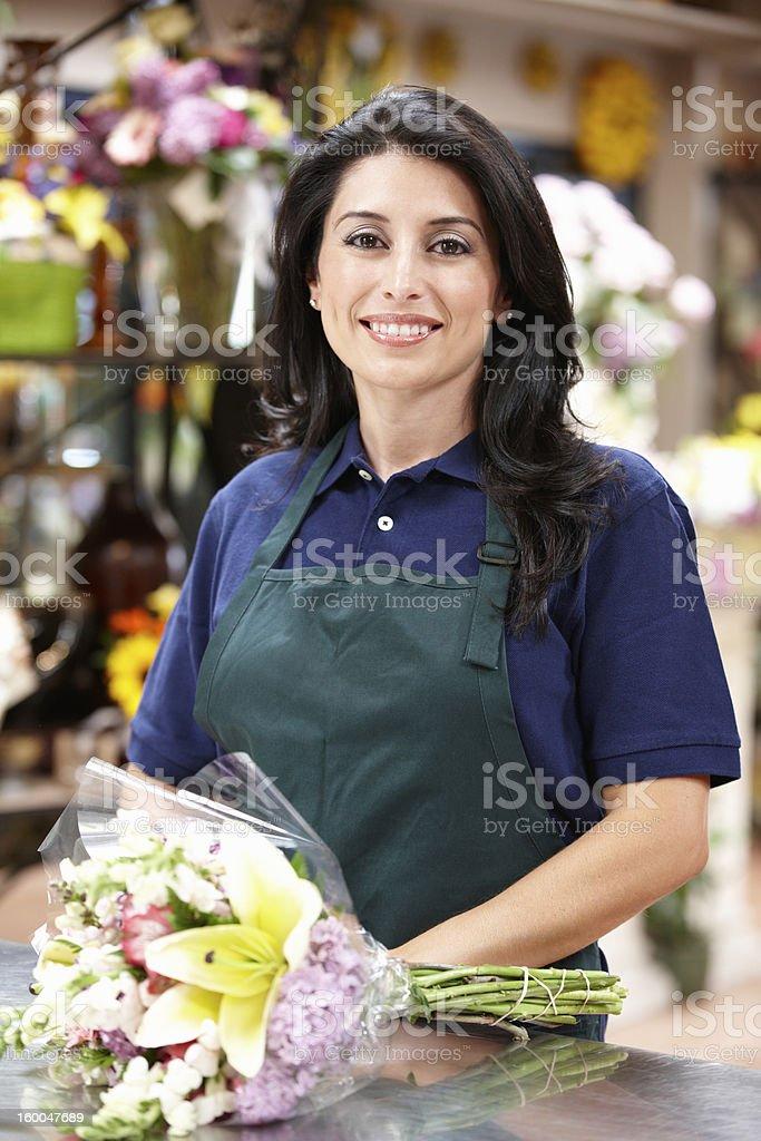 Hispanic woman working in florist royalty-free stock photo