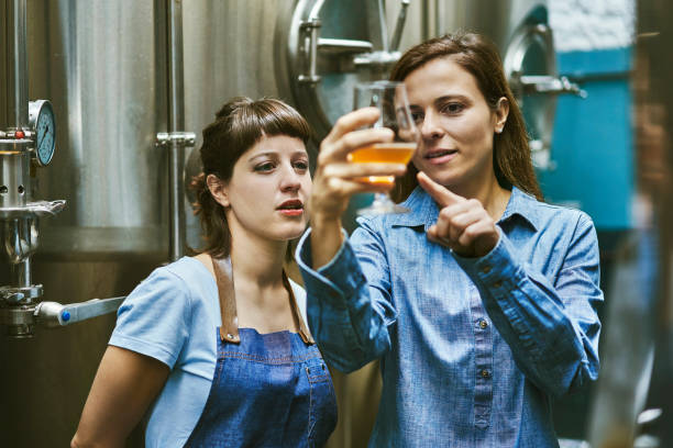 Hispanic Women Checking Quality of Craft Beer in Brewery – Foto