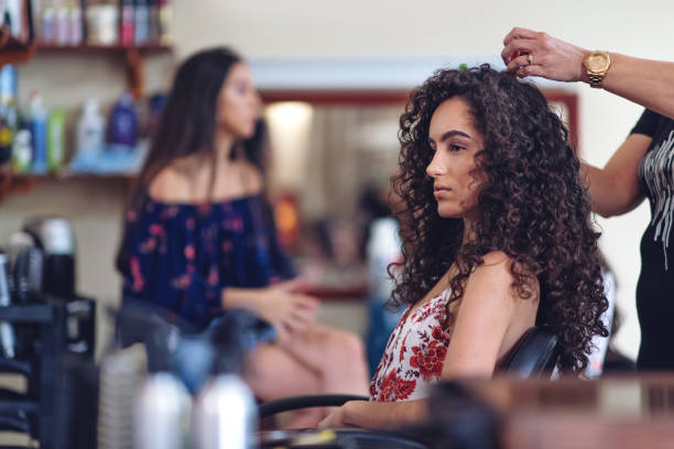 Hispanic women in a hair salon stock photo