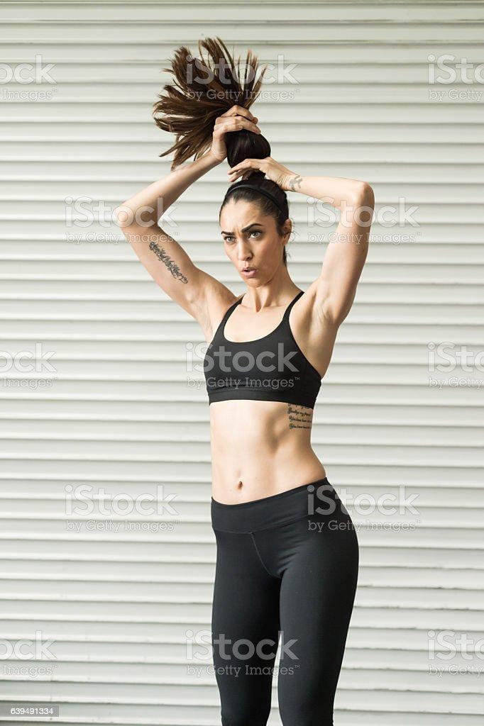 Hispanic Women Pulling Back Her Hair stock photo