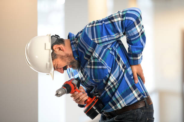 Hispanic Worker Experiencing Back Pain stock photo