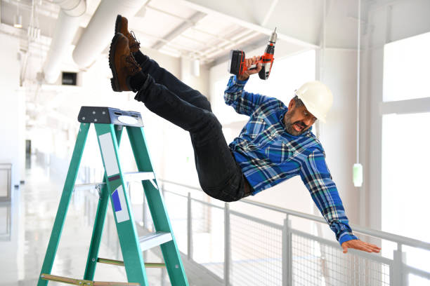 Hispanic Worker Falling from Ladder stock photo