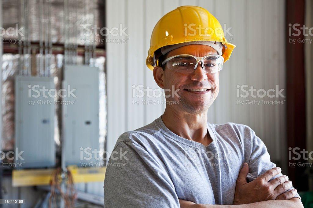 Hispanic worker wearing hard hat royalty-free stock photo