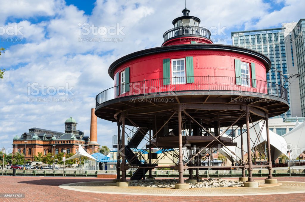 Histor Lighthouse on the Waterfront of Baltimore on a Sunny Autumn Day stock photo