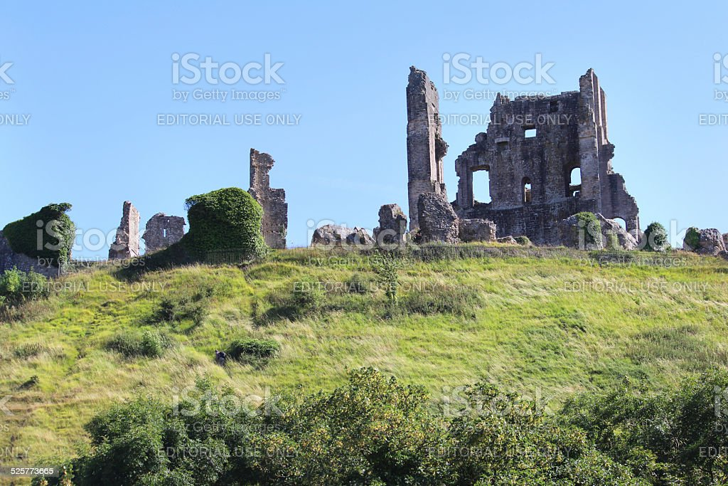 Historic 11th-century Corfe Castle ruins / fortifications on hill-top, Dorset, England stock photo