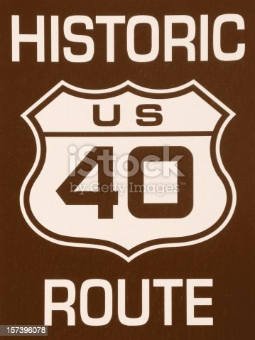 A close up of a Historic 40 Route sign in sepia.  Route 40 was an historic route that ran from Atlanta,Georgia to San Francisco, California.