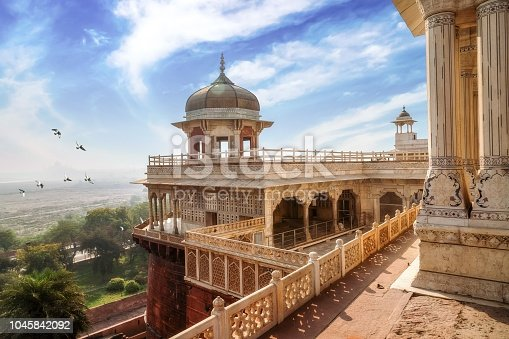 istock Historic Agra Fort with white marble dome architecture and carvings and portico structure. View of intricately carved Diwan-i-Khas and Musamman Burj dome of Agra Fort. 1045842092