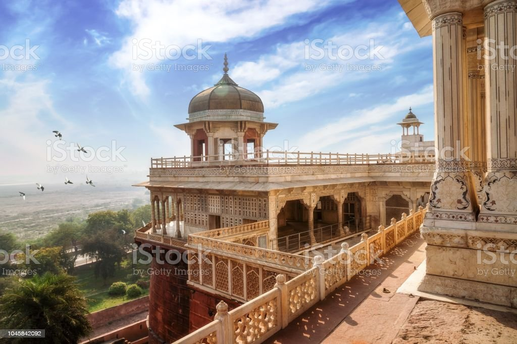 Historic Agra Fort with white marble dome architecture and carvings and portico structure. View of intricately carved Diwan-i-Khas and Musamman Burj dome of Agra Fort. stock photo