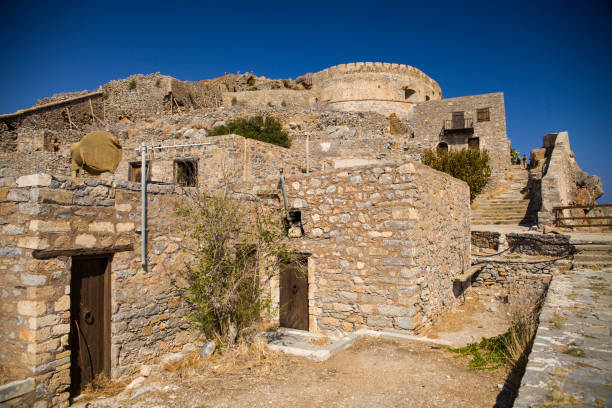 Historic architectural buildings on the island of Spinalonga. Buildings in the Spinalonga fortress in Crete, Greece. – zdjęcie
