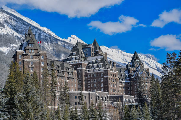 historic banff springs hotel in banff, canada - banff national park stock photos and pictures