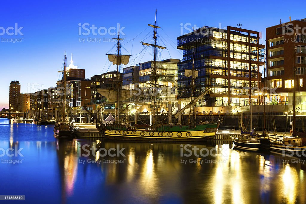 Historic boats in a modern City stock photo