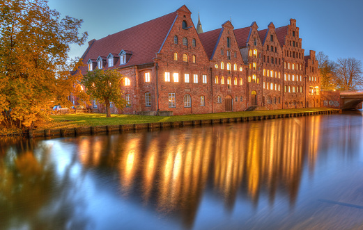 Historic brick buildings on Trave River. Lubeck, Germany
