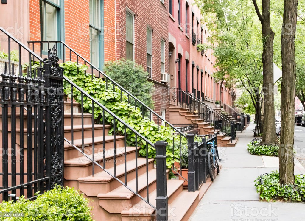 Historic brownstone buildings in the West Village neighborhood of Manhattan in New York City stock photo