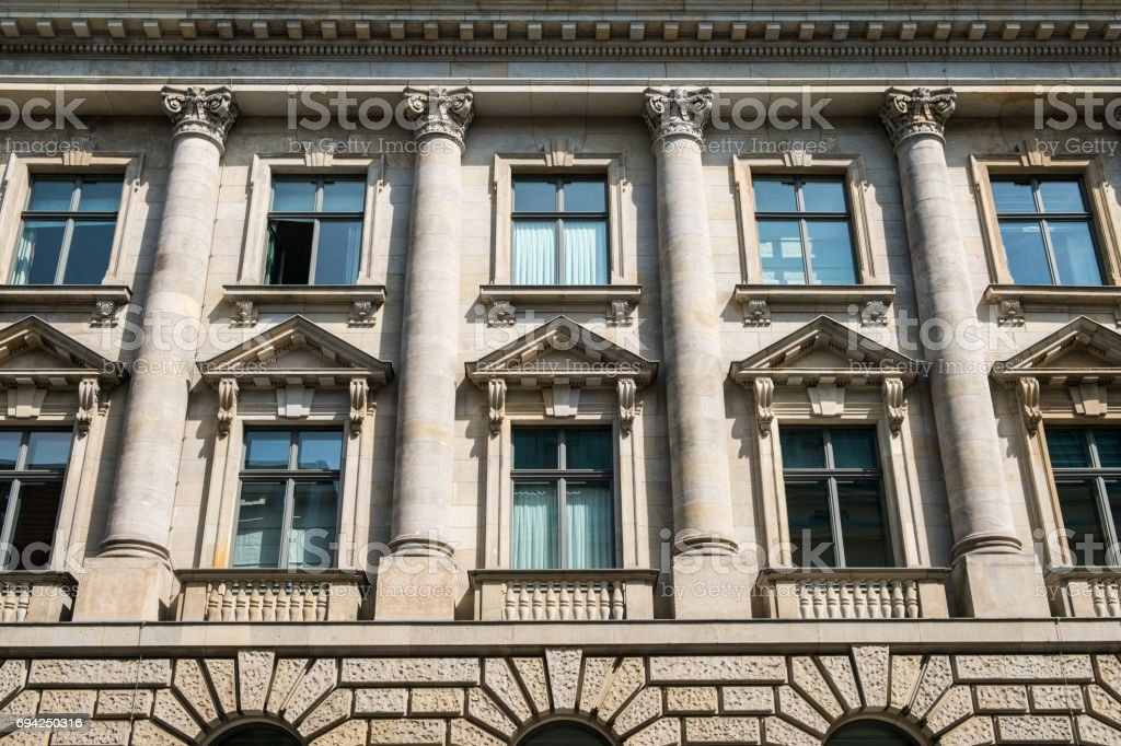 historic building facade with columns stock photo