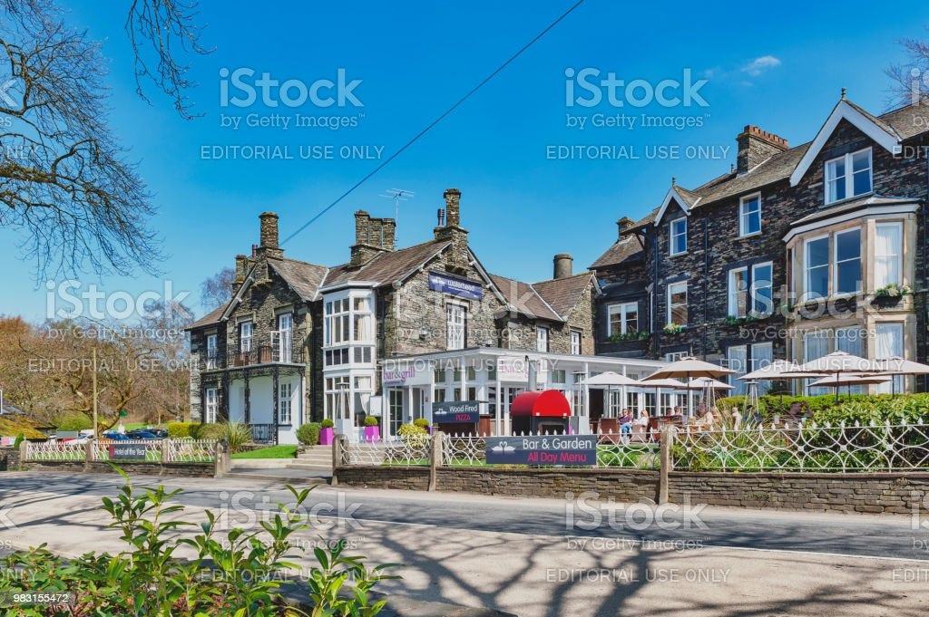 Historic buildings at Ambleside, a small lakeside town situated at the head of Windermere Lake within the Lake District National Park in England stock photo