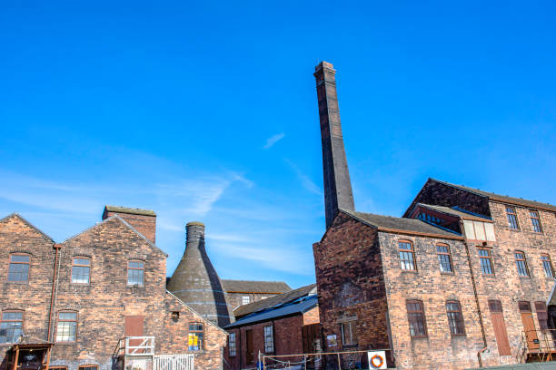 Historic buildings of potteries with bottle oven located on banks of Trent and Mersey canal in Stoke on Trent, Staffordshire,Uk. stock photo