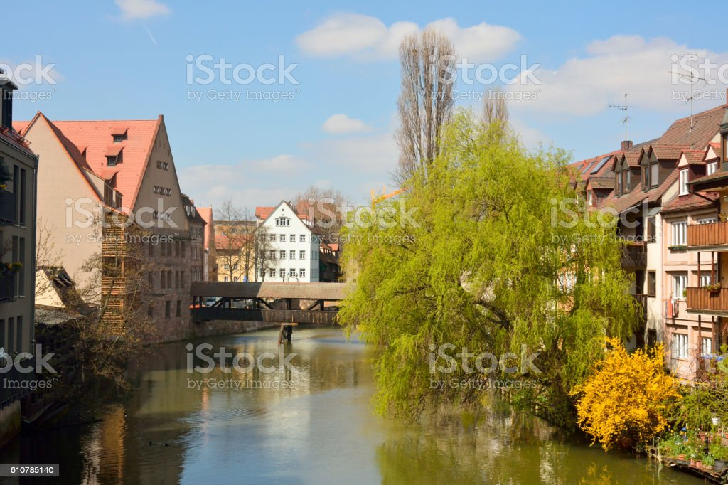 Historic buildings on Pegnitz riverside in Nuremberg old town district. stock photo