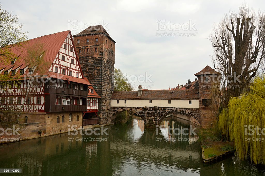 Historic buildings on the bank of Pegnitz river in Nuremberg stock photo