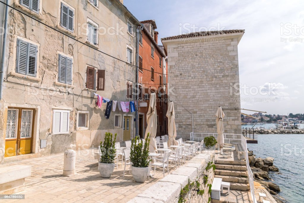 Historic buildings on the coast of Rovinj town on Adriatic sea. royalty-free stock photo